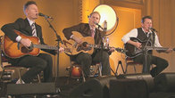 Click to play clip: Joe Ely, John Hiatt and Lyle Lovett - Blowin' Down The Road