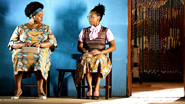 Precious Ramotswe (Jill Scott) sizes up Grace (Anika Noni Rose)